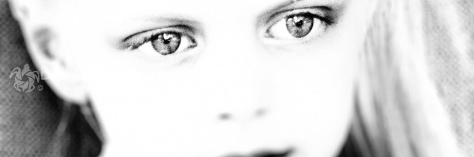 Eyes in Focus; a candid soft focus portrait of little girl where only her eyes are in sharp focus; black and white photo by Charles Burgess; www.burgessphotog.com; Commercial – Conceptual -Lifestyle – Photography; All Rights Reserved.